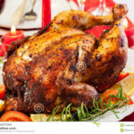 Baked Chicken For Christmas Dinner Stock Photo - Image of ...