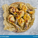 Baked Chicken Legs On Kraft Paper. Gray Background, Top View …