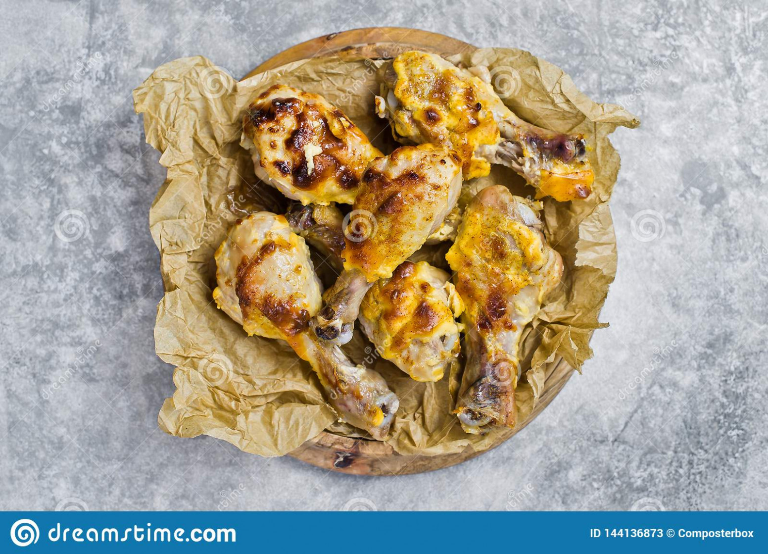 Baked Chicken Legs On Kraft Paper. Gray Background, Top View ...