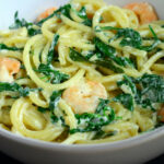 Bucatini With King Prawns, Cream, Rocket, And An Edge Of Curry Leaf