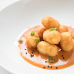 Garlic Tater Tots With Spicy Asian Dipping Sauce