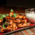 Grilled Chicken Wings With Spicy Chipotle Hot Sauce And Blue Cheese Yogurt Dipping Sauce