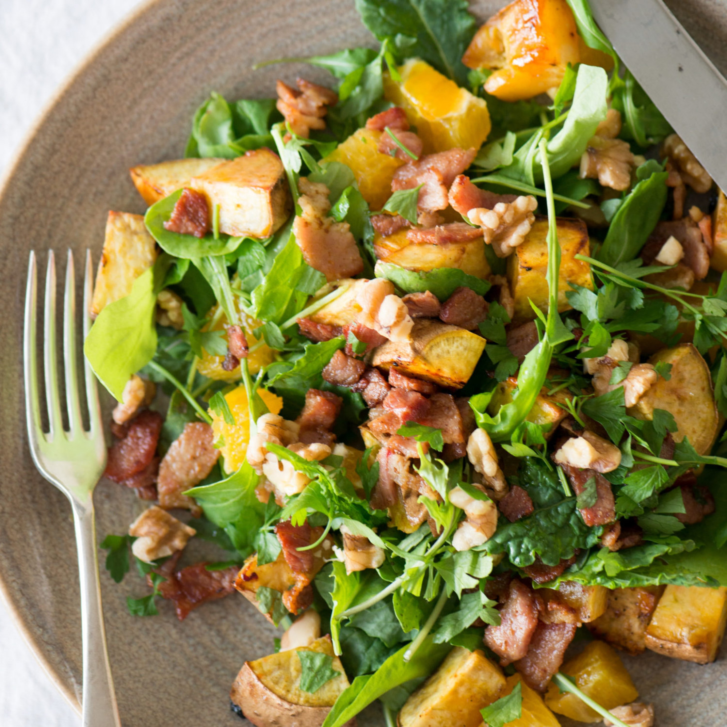 Kumara, bacon, walnut and orange salad