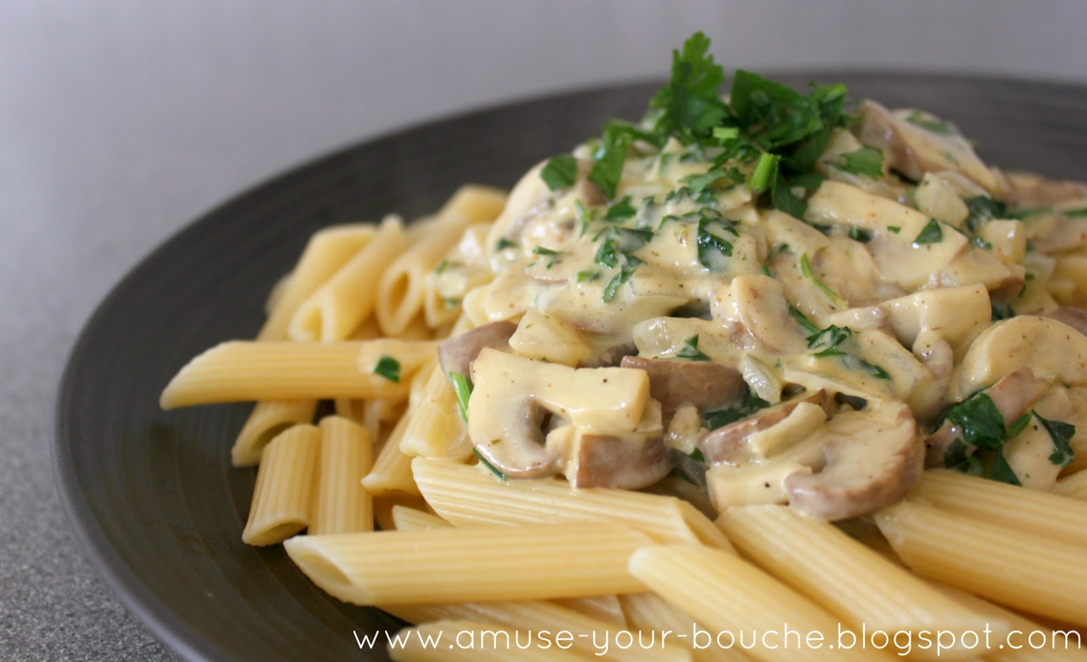 Pasta in a creamy mushroom and white wine sauce - Amuse ...