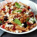 Pasta With Tomatoes And Goat Cheese Recipe — Dishmaps