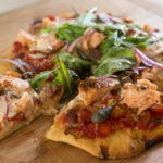 Smoked Salmon Pizza with tomato and rocket by Nadia Lim
