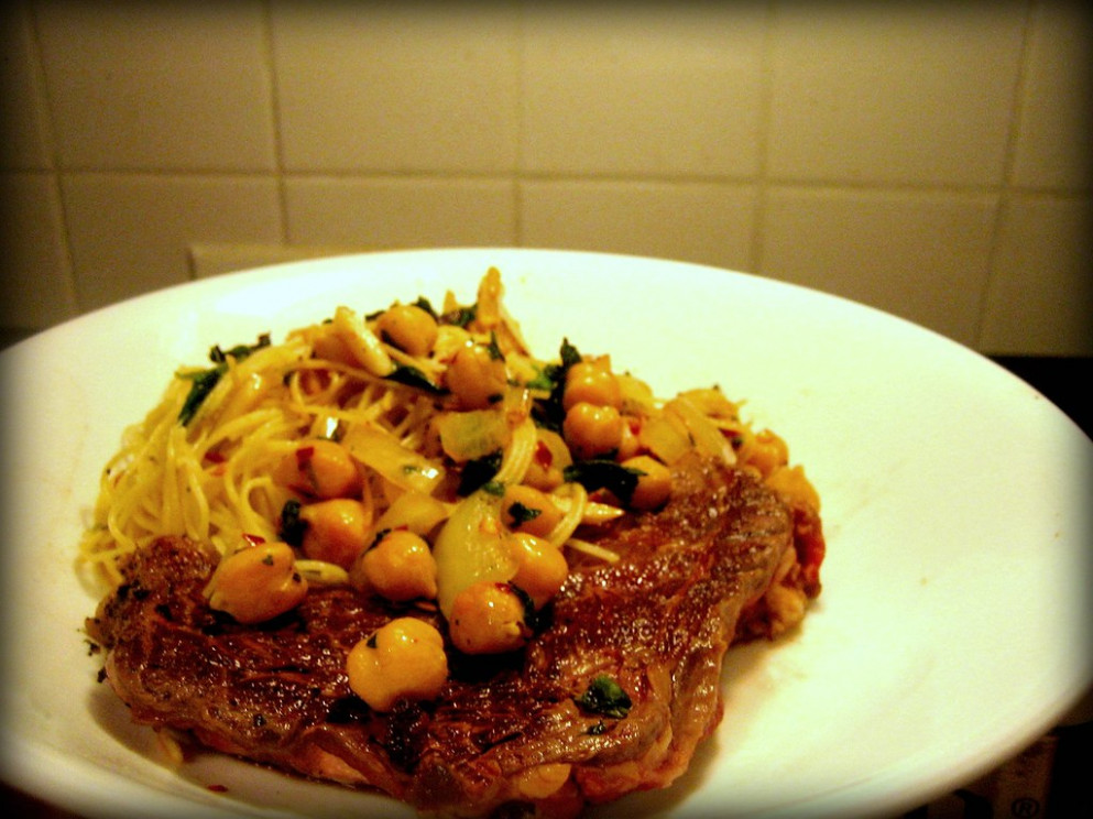 Steak & angel hair pasta with chickpeas, veggies, almonds, and crushed red pepper