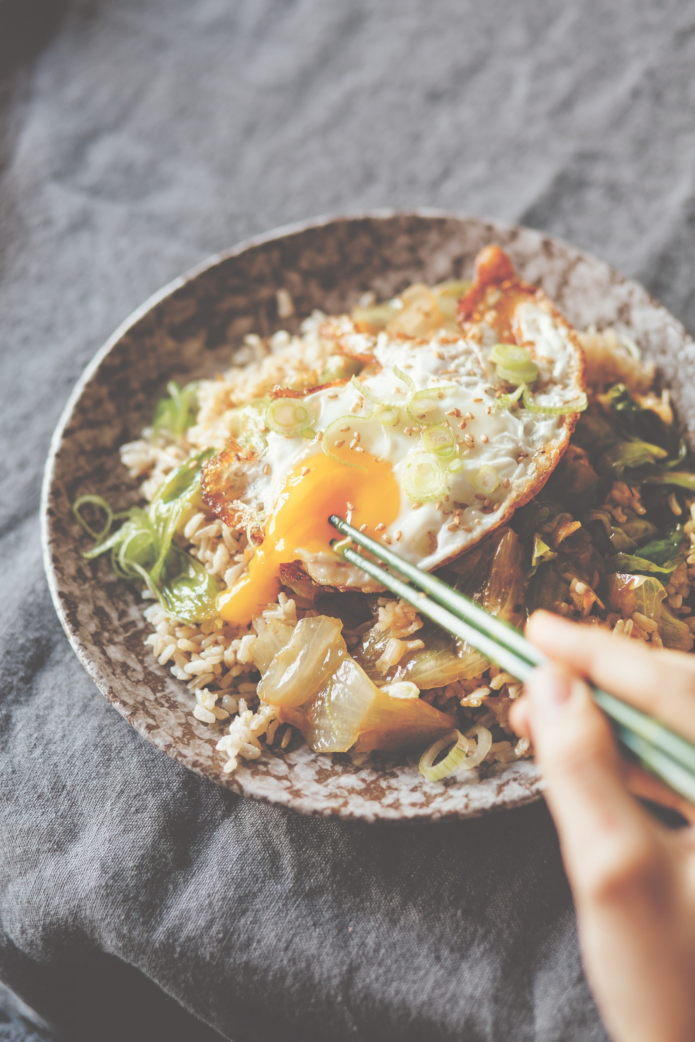 Stir-fried lettuce bowl with ginger fried rice and fried egg