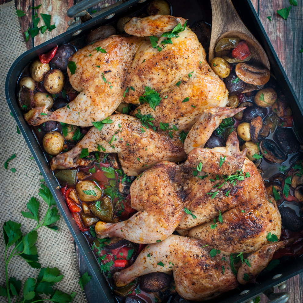 Butterflied roast chicken on veggies